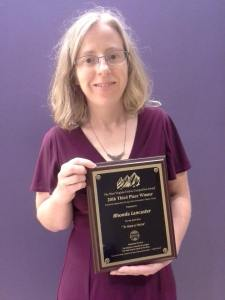 rhonda-with-award